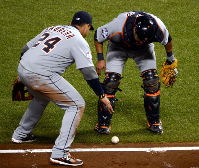 Miguel Cabrera and Gerald Laird of the Tigers wait to see if the ball goes foul on a bunt single by the Giants' Gregor Blanco during Game 2 of the World Series in San Francisco.