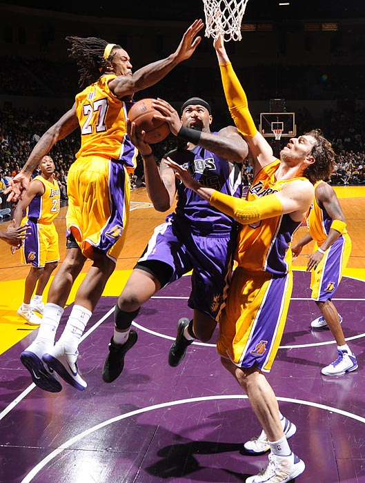 DeMarcus Cousins goes up against the Lakers' Jordan Hill and Pau Gasol during a preseason game at the Valley View Casino Center.
