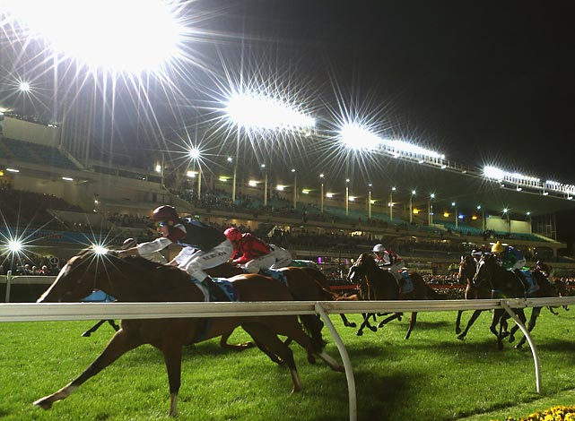 Captured here with a star filter, Michael Rodd rides Angelic Light to victory in the Printhouse Crokett Stakes at Moonee Valley Racecourse in Melbourne, Australia.
