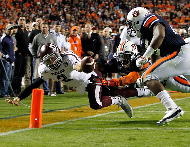Texas A&M quarterback Johnny Manziel stretches the ball for a touchdown against Auburn. The Aggies ran away with it, defeating the Tigers 63-21.