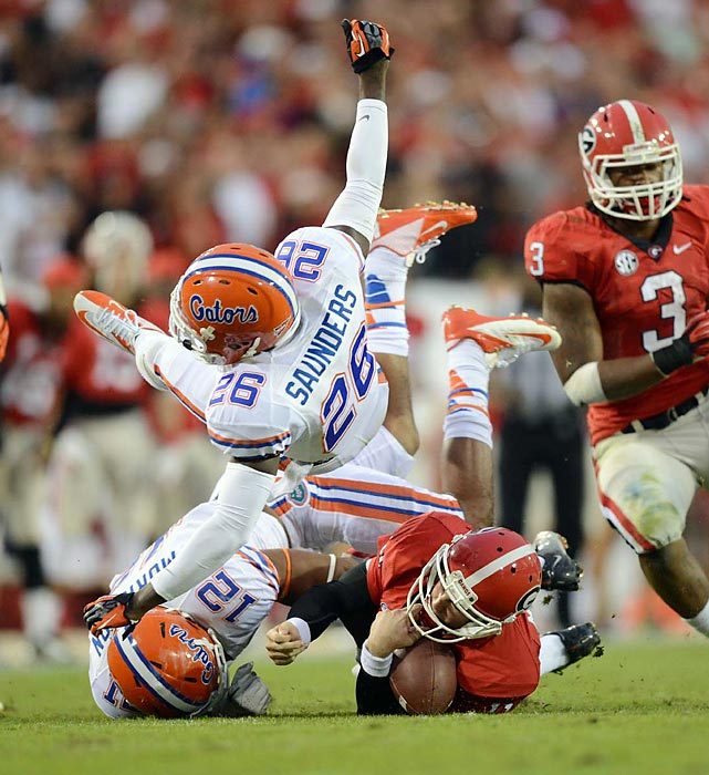 Safety De'Ante Saunders flies through the air as he makes a tackle. Saunders and his Florida teammates lost their first game of the season, as they were upset by the Georgia Bulldogs, 17-9.