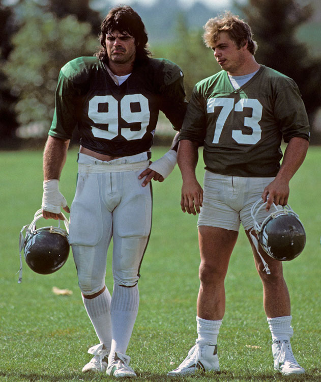 Gastineau and Klecko rest during a training camp practice in East Rutherford, NJ.