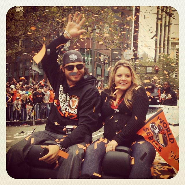 Brandon Crawford and his wife showered in confetti.