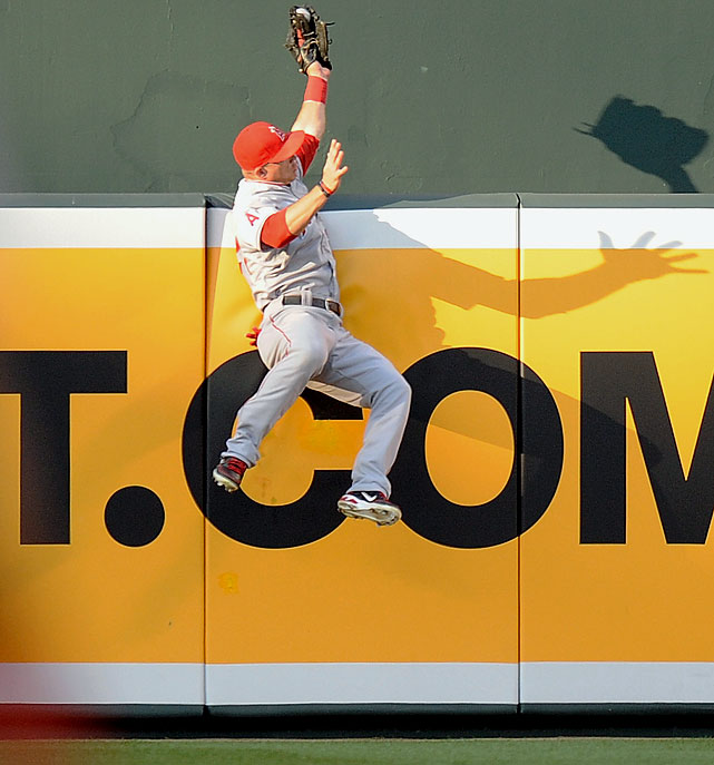 "Only two months after he arrived in ""The Show"" and began one of the best rookie seasons in baseball history, Mike Trout made perhaps of the catch of the year on June 27, 2012 when he leapt to snag a sure homer away from the Orioles' J.J. Hardy."