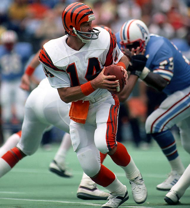 In a 35-27 victory over the Houston Oilers, quarterback Ken Anderson throws 20 consecutive passes and finishes the season winning his second consecutive passing title. He finished the season with a 70.55% completion percentage, which was a record at the time.