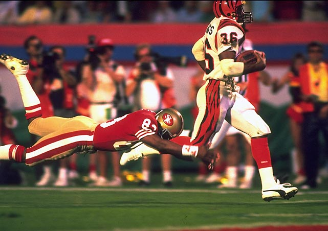 Less than a minute from their first world championship, the Bengals watch Joe Montana throw a 10-yard TD pass to John Taylor with 34 seconds left as the 49ers win Super Bowl XXIII, 20-16. Stanford Jennings highlights the Bengals' effort with a 93-yard kickoff return for a brief 13-6 third quarter lead.