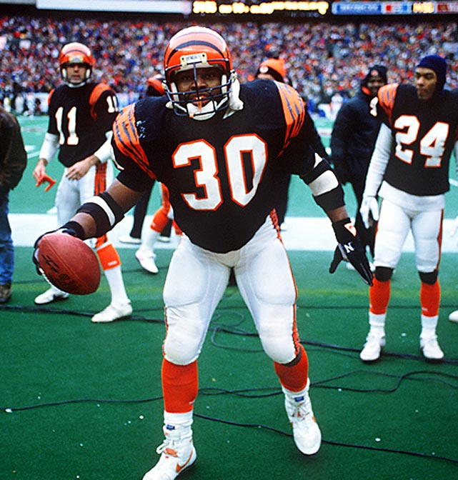 Rookie Icky Woods rushes for 102 yards and two TDs as Bengals defeat Buffalo 21-10 to qualify for their second Super Bowl. Cincinnati defense intercepts two of Jim Kelly's first two passes, three overall.
