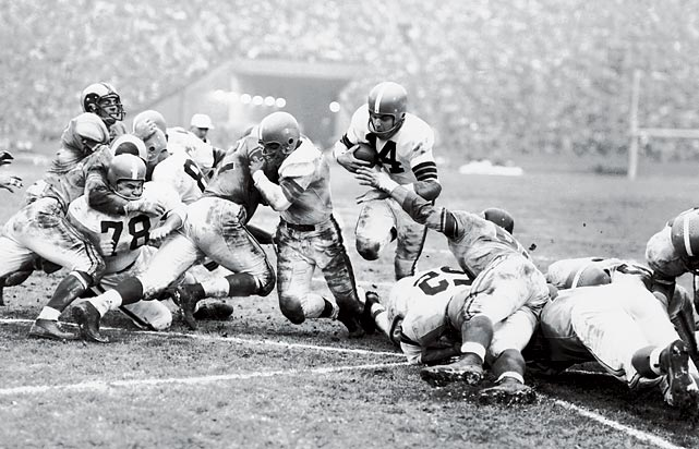 Playing his final game, Otto Graham throws for 209 yards and two TDs and runs for two more as Browns rout the Rams 38-14 for their second straight NFL title and third in six years. Don Paul sets a championship game record by returning an interception 65 yards for a score.