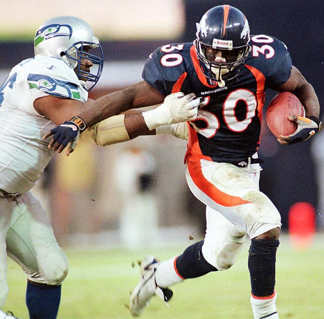 Terrell Davis charges past several Seattle Seahawks defenders to record only the third 2,000 yard rushing season in NFL history. Davis won his third consecutive AFC rushing title, his first NFL rushing title, and was named league MVP. The Broncos won their second consecutive Super Bowl that year by beating Atlanta 33-19.