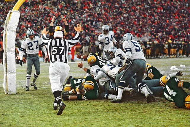 "The Packers and Cowboys compete in the legendary ""Ice Bowl."" Temperatures fall to as low as 13-below at Lambeau Field, but the heroic Bart Starr sneaks the ball in from the one-yard line to clinch the NFC Championship over the Cowboys."