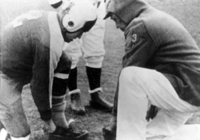 """The Giants outscored the Bears 27-0 in the fourth quarter for their first NFL title of the playoff era. The contest was remembered as the """"Sneakers Game"""" after Giants players switched to basketball shoes at halftime to better navigate the Polo Grounds' icy turf."""