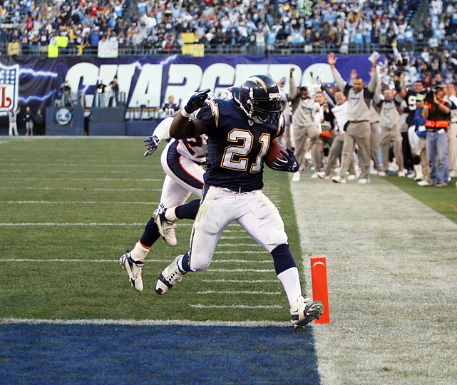 League MVP LaDainian Tomlinson scores on a seven-yard run to set the NFL single-season rushing record at 29. He extended it to 31 a week later, when he also broke Paul Hornung's 46-year-old NFL single-season scoring mark by reaching 186 points.