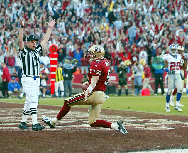 In a wild-card playoff game against the Giants, San Francisco trails, 38-14, with four minutes left in the fourth quarter only to rally for a 39-38 victory. Quarterback Jeff Garcia throws two touchdown passes and runs for another as the 49ers register the second-largest comeback in postseason history.