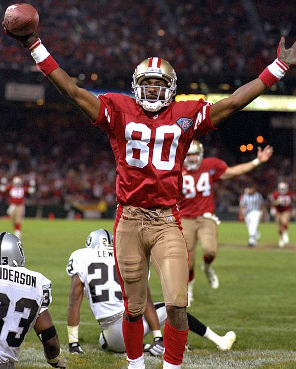 In a nationally televised game against the Raiders, wide receiver Jerry Rice scores his 127th touchdown, breaking the NFL record held by Browns fullback Jim Brown. Rice goes on to finish his Hall of Fame career with 208 touchdowns--an NFL mark that still stands.