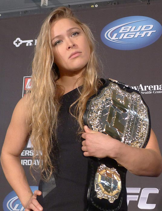 Ronda Rousey shows off her UFC bantamweight championship belt during a news conference in Seattle, Wash. UFC president Dana White handed out the belt, saying the former Strikeforce title-holder will make her UFC debut on Feb. 23 against Liz Carmouche.