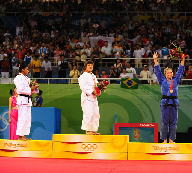 Rousey stands on the podium after winning bronze at the 2008 Olympics.