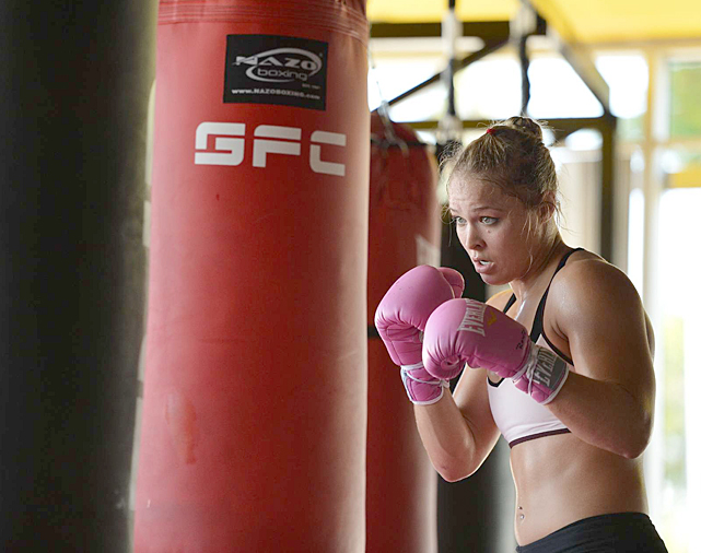 Rousey works out on the punching bag.