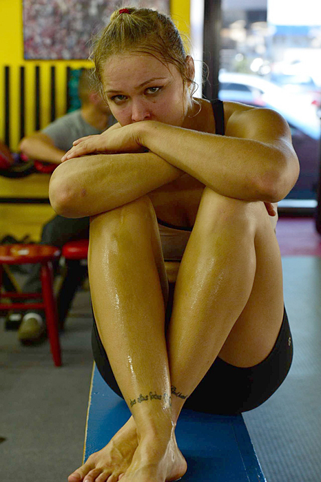 Rousey catches her breath after a workout.