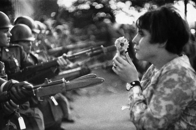 No discussion of 1967 is complete without mentioning the Vietnam War and the controversy surrounding it. In one of the most famous images of the time, Jane Rose Kasmir holds a flower up to soldiers during an anti-war demonstration outside the Pentagon.