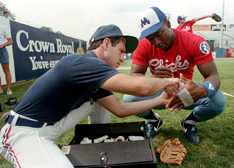Class AA Memphis Chicks athletic trainer Steve Morrow tends to a blister on Jackson's finger.