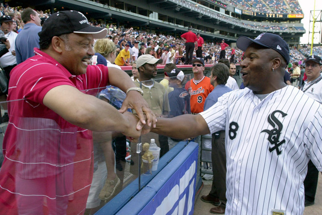 Rev. Jesse Jackson shares a laugh with Jackson before the Legends & Celebrity softball game.