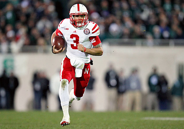 Michigan State was ahead for the majority of the game, but Nebraska used a fourth-quarter surge to add to its lead in the Legends Division standings. Trailing 24-14 in the fourth quarter, the Huskers executed two touchdown drives, the former finishing with a 35-yard Taylor Martinez run and the latter ending with a five-yard pass to Jamal Turner. Le'Veon Bell rushed for 188 yards and two scores, but it wasn't enough. Martinez (pictured) outdid him by racking up 365 total yards and four touchdowns.