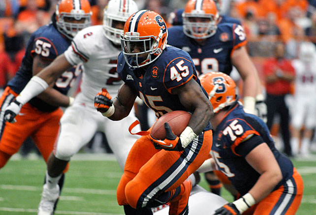 Louisville's perfect season is no more. Syracuse wiped out the Cardinals behind a relentless offensive showing in the Carrier Dome. Ryan Nassib threw for 246 yards and three touchdowns, Jerome Smith (pictured) scampered for 144 yards and a score and Alec Lemon caught nine passes for 176 yards and two touchdowns. Louisville quarterback Teddy Bridgewater went 36-of-49 for 424 yards and three scores in the loss.