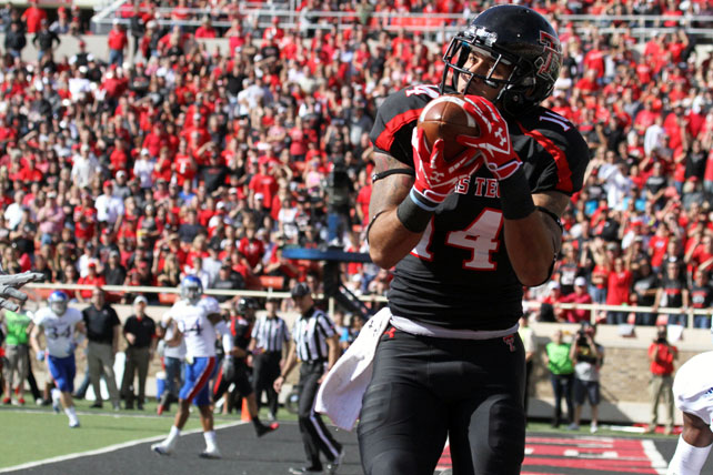 It was significantly closer than expected, but the Red Raiders put an end to their two-game losing streak against Kansas. Quarterback Seth Doege threw for 476 yards and three scores, while wideout Eric Ward made 12 catches for 180 yards. Senior receiver Darrin Moore (pictured) made the game-winning touchdown catch in double overtime.