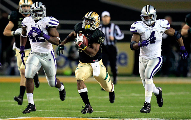 Oregon wasn't the only BCS heavyweight to fall on Saturday night. Previously overlooked Baylor stunned Kansas State behind an explosive offensive performance. Quarterback Nick Florence passed for 240 yards and two touchdowns, running back Lache Seastrunk (pictured) galloped for 183 yards and a score and junior back Glasco Martin ran for 113 yards and three touchdowns as the Bears took down the Wildcats. Baylor, which came into the game ranked 115th in the FBS in scoring defense, allowed a mere seven points in the second half.