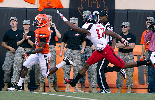 Texas Tech's late-season struggles continue. After racing to a 6-1 start, the Red Raiders have now dropped three of their past four games, contests in which their defense has failed to live up to its billing. Saturday brought more of the same. The Cowboys steamrolled Tommy Tuberville's team behind standout efforts from Clint Chelf and Isaiah Anderson (pictured). Chelf completed 11-of-21 attempts for 229 yards and three touchdowns, and Anderson made four grabs for 174 yards and all three receiving scores.