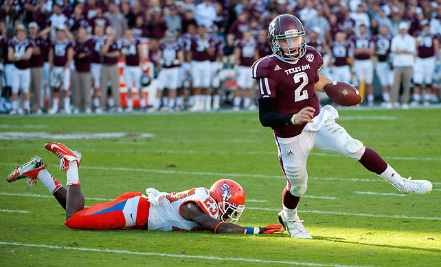 It may have been against a cupcake team, but in Week 12 Johnny Manziel (pictured) picked up right where he left off after upsetting then No. 1 Alabama last week. Johnny Football threw for 267 yards and three touchdowns and ran for 100 yards and two more scores. He broke the NCAA records for rushing yards by a freshman quarterback and total yards of offense by a freshman.