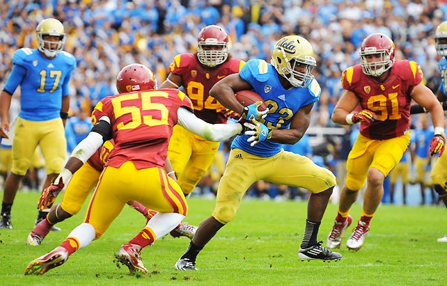 USC's football monopoly really might be over. UCLA beat its archrival for the first time since 2006, securing the Pac-12 South title in the process. The Bruins got a big day from Johnathan Franklin (pictured), who rushed 28 times for 160 yards and two scores. Matt Barkley and Marqise Lee, USC's best offensive players, committed three combined turnovers.