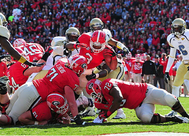 Georgia could be one victory away from playing for a national title. Though the Bulldogs still need to win in the SEC championship game, they stayed in BCS contention by routing Georgia Tech on Saturday, a contest they controlled from the opening kick. Freshman back Todd Gurley (pictured) scored just 1:03 into the game and finished with 97 yards and two touchdowns, and counterpart Keith Marshall racked up 66 yards and two scores. Quarterback Aaron Murray was accurate and efficient, going 14-of-17 for 215 passing yards and two touchdowns.