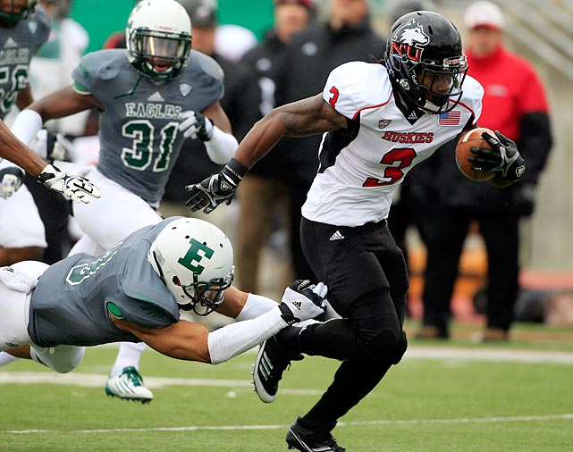Northern Illinois quarterback Jordan Lynch passed for 168 yards and ran for 107 yards, and Akeem Daniels (pictured) scored a career-best four touchdowns as the Huskies took down Eastern Michigan on a cold, snowy Friday. Lynch has now rushed for at least 100 yards in 10 consecutive games, an NCAA record for quarterbacks.