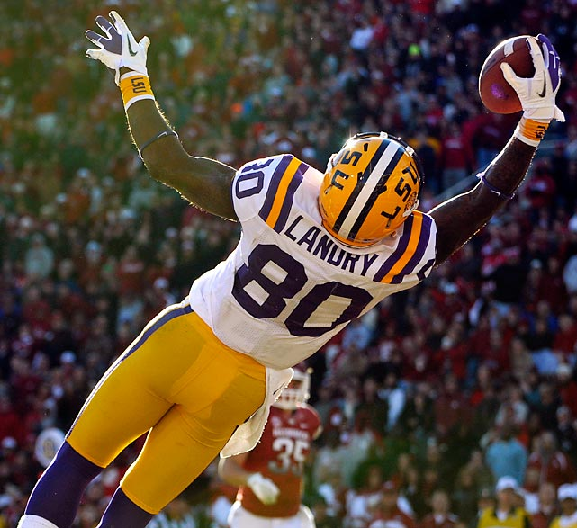 Jarvis Landry (pictured) helped LSU keep a possible BCS bowl berth within reach.Landry made a spectacular, one-handed touchdown grab and the Tigers held on for a 20-13 win over Arkansas on Friday. Zach Mettenberger passed for 217 yards and hooked up with Landry for the play of the day with 1:12 left in the first half to put LSU up 10-0. The Tigers (10-2, 6-2 in the SEC) reached the double-digit win plateau for the sixth time in eight seasons under coach Les Miles.