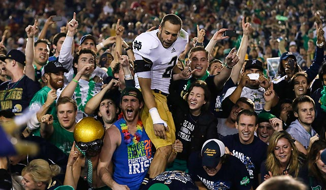 The Fighting Irish are BCS title game bound. Notre Dame completed an improbable undefeated regular season by surviving USC in Los Angeles to lock up a spot in Miami on Jan. 7. Everett Golson didn't throw a touchdown pass, but the Irish relied on the stout defense that's helped them all year, stopping the Trojans four consecutive times from the one-yard line as the seconds ticked away. Notre Dame has not won a title in 24 years.