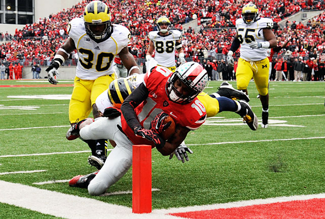For the first time since winning the national championship after the 2002 season, Ohio State is perfect. The Buckeyes capped an undefeated campaign by outlasting Michigan in a back-and-forth affair in Columbus. The Wolverines put a scare in the Ohio State crowd after long touchdowns by Roy Roundtree and Denard Robinson, but the Buckeye stars stepped up in response. Braxton Miller went 14-of-18 for 189 yards and a touchdown, and Carlos Hyde ran for 123 yards and a score. Wideout Corey Brown (pictured) made a 14-yard touchdown grab in the second quarter.