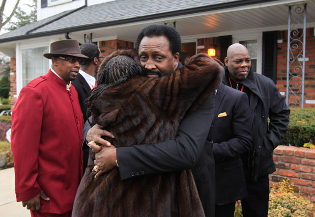 Thomas Hearns receives a hug outside the home of Steward in Detroit on Tuesday.