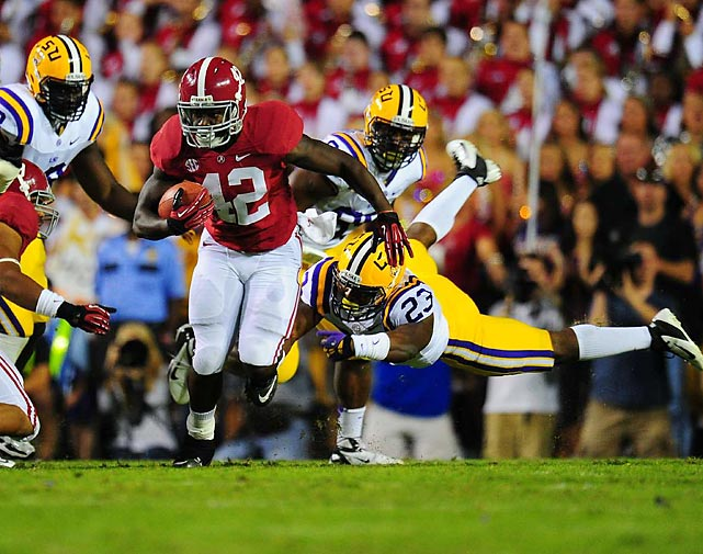 Alabama's Eddie Lacy breaks loose and eludes the LSU defense.