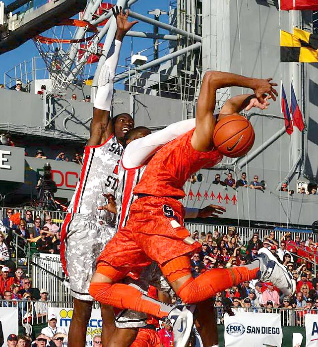 Two San Diego State defenders protect the rim during the Battle of the Midway on Sunday afternoon. The Aztecs played Syracuse on the USS Midway in San Diego, and the Orange coasted to a 62-49 win.
