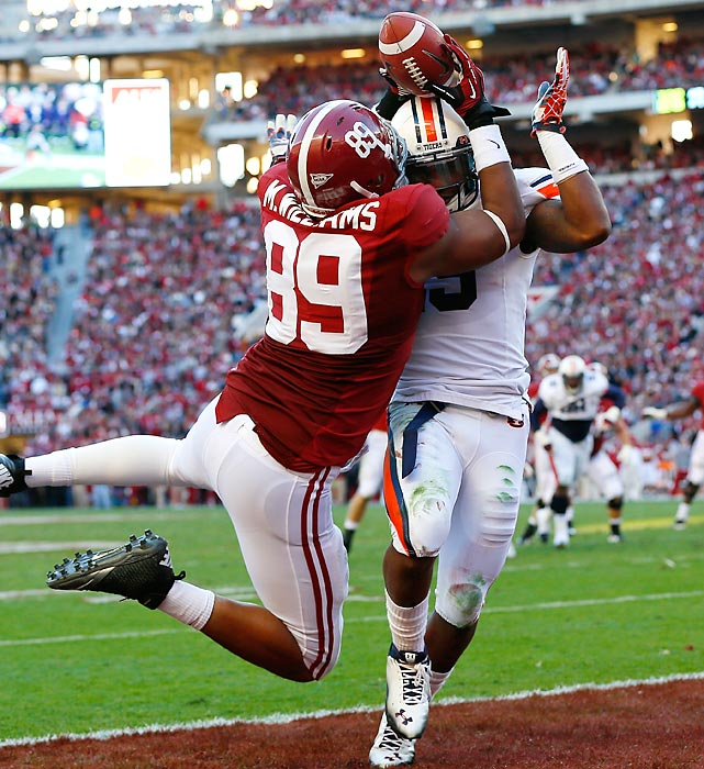 Alabama's Michael Williams goes up for a pass against Auburn's Daren Bates. The pass went incomplete, but Williams and his teammates still finished with a 49-0 victory.