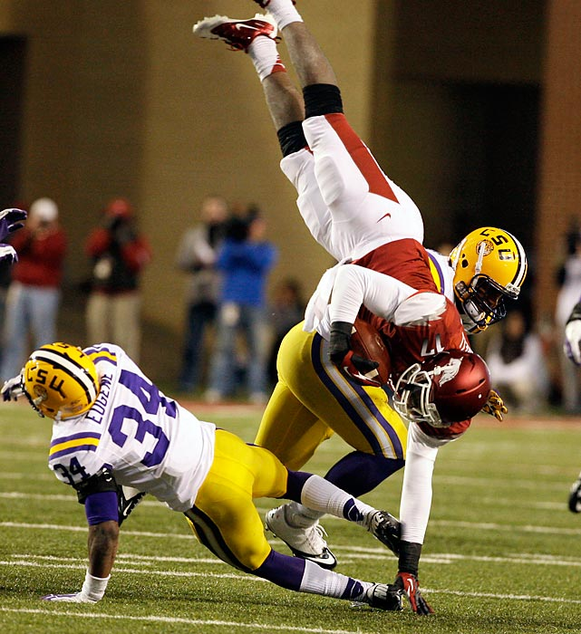 LSU's Kevin Minter and Micah Eugene team up to send Arkansas quarterback Brandon Mitchell flying.