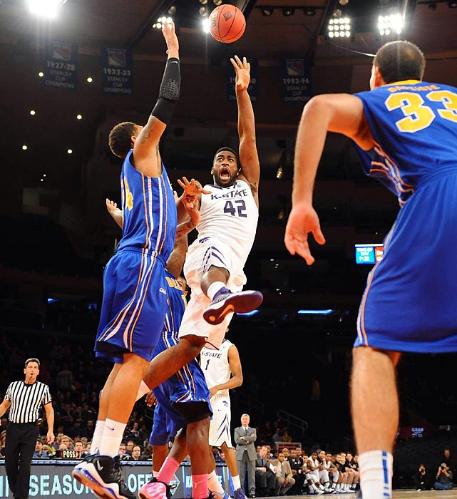 Kansas State forward Thomas Gipson drives to the basket against Delaware in the Preseason NIT tournament in New York's Madison Square Garden. The Wildcats hung on for a 66-63 win over the Blue Hens.