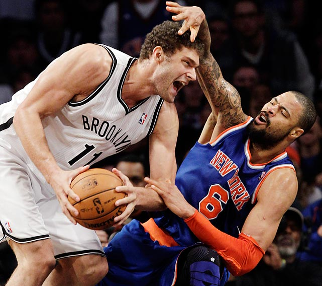 Nets center Brook Lopez collides with Knicks center Tyson Chandler at the Barclays Center in Brooklyn. In what was the first matchup between professional teams from Brooklyn and Manhattan in decades, the Nets won 96-89.