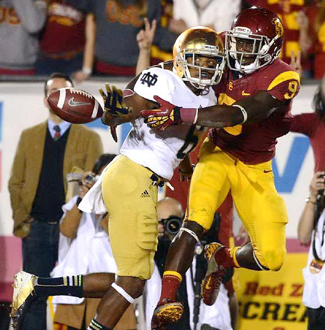Notre Dame cornerback KeiVarse Russell commits pass interference against USC receiver Marqise Lee in Los Angeles. The Fighting Irish won 22-13, improving their record to 12-0 and sending them to January's BCS Championship.