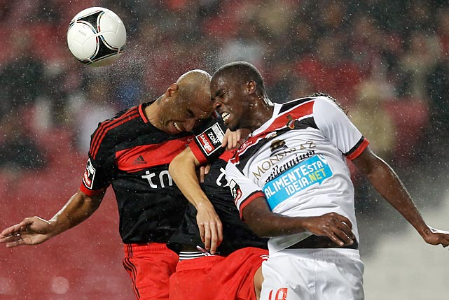 Benfica's Luisao, left, knocks heads with Olhanense's Djaniny in Lisbon.
