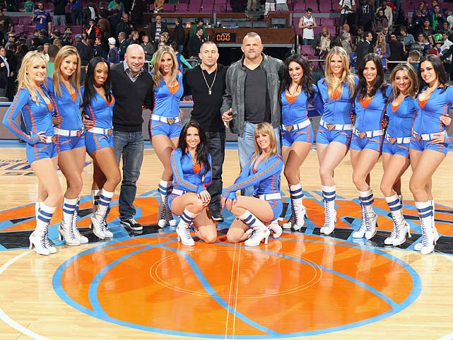 Dana White, Georges St-Pierre and Chuck Liddell pose for a picture with the Knicks City Dancers after the game between New York Knicks and the Memphis Grizzlies on March 17, 2011 at Madison Square Garden.