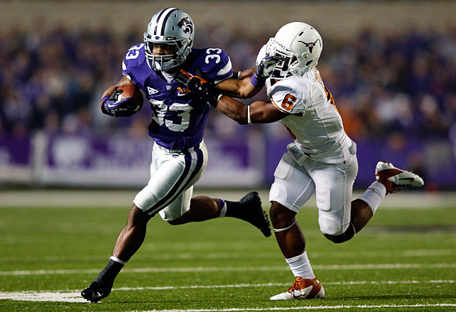 Kansas State is bound for a BCS bowl. Despite trailing the Longhorns 17-14 in the third quarter, the Wildcats rallied to lock up their place atop the Big 12 standings. Heisman candidate Collin Klein accounted for 287 total yards and three touchdowns, while running back John Hubert (pictured) collected 66 rushing yards and three more scores. Kansas State rattled off 28 unanswered points in a span of fewer than 15 minutes in the second half.