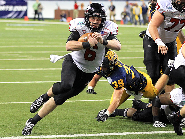 Friday night MACtion did not disappoint. Bolstered by a star performance from quarterback Jordan Lynch (pictured), Northern Illinois defeated Kent State in double overtime to win the MAC Championship Game. Lynch passed for 212 yards, rushed for 160 yards and scored four total touchdown, while Huskies running back Akeem Daniels scampered for another 170 yards and a score. Lynch's two-yard touchdown on the first possession of double overtime proved to be the game-winner.
