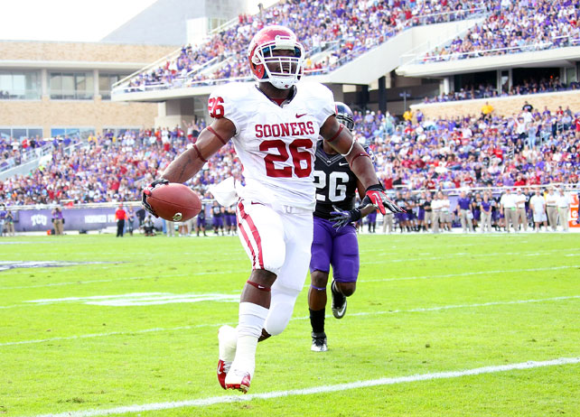 Oklahoma has clinched a share of the Big 12 title. The Sooners secured a tie atop the league standings after outlasting TCU in Fort Worth. Landry Jones completed 22-of-40 attempts for 244 yards and two scores, and Damien Williams (pictured) added touchdowns of 11 and 66 yards, respectively. Bob Stoops' team won each of its last five contests -- three on the road -- to finish the regular season with a record of 10-2.